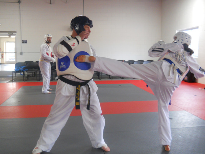 Traverse City Taekwondo Sparring Class - Why Martial Arts Makes You A Better Parent, Spouse and Pers