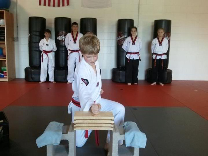 Martial Arts Black Belts From Traverse City Are Changing The World One Kick And Punch At A Time!