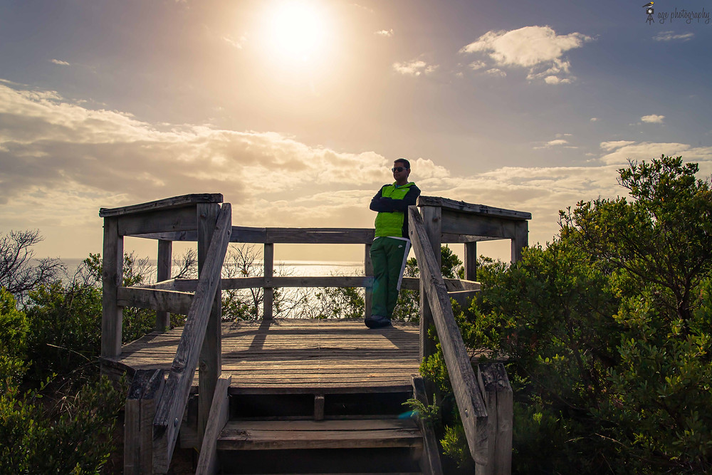 Image of a person spending time at a coastal viewing platform