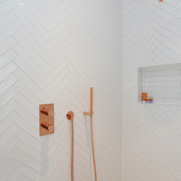 white tiles with copper bathroom shower accessories