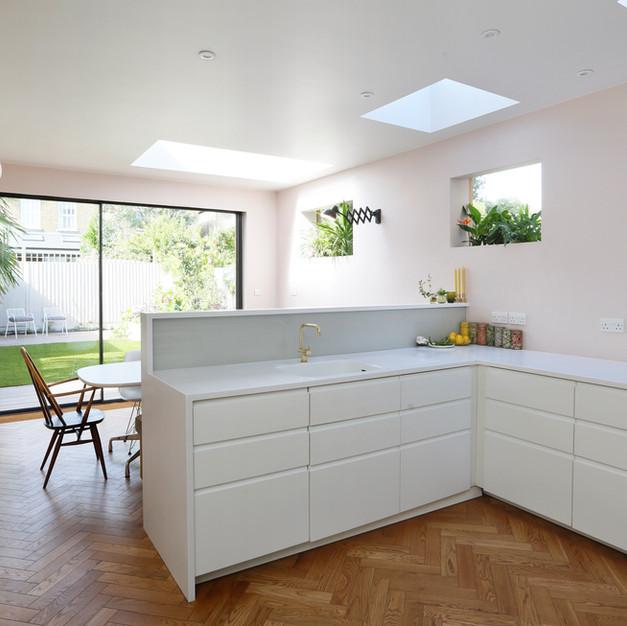 pink kitchen with sunken window planters