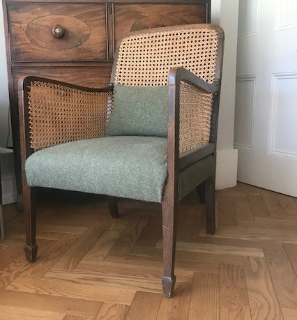 cane and upholstered chair