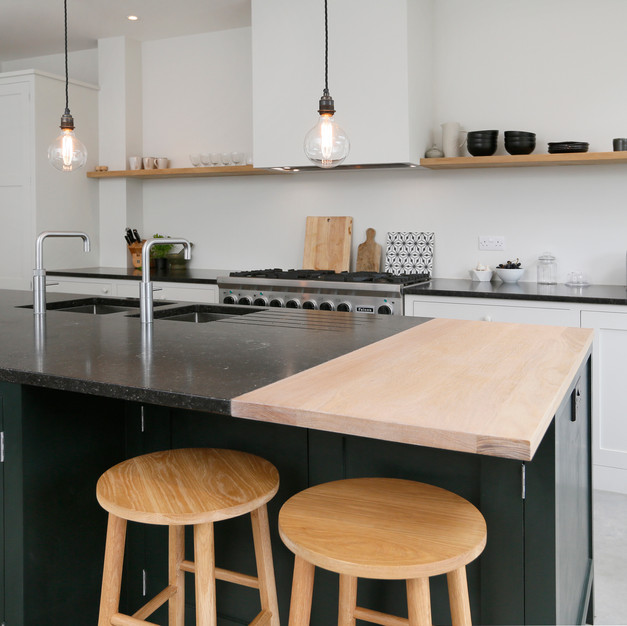 two material kitchen island with wooden stalls