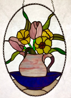 Stained glass flowers in water pitcher