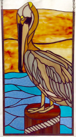 Stained glass Pelican at sunset