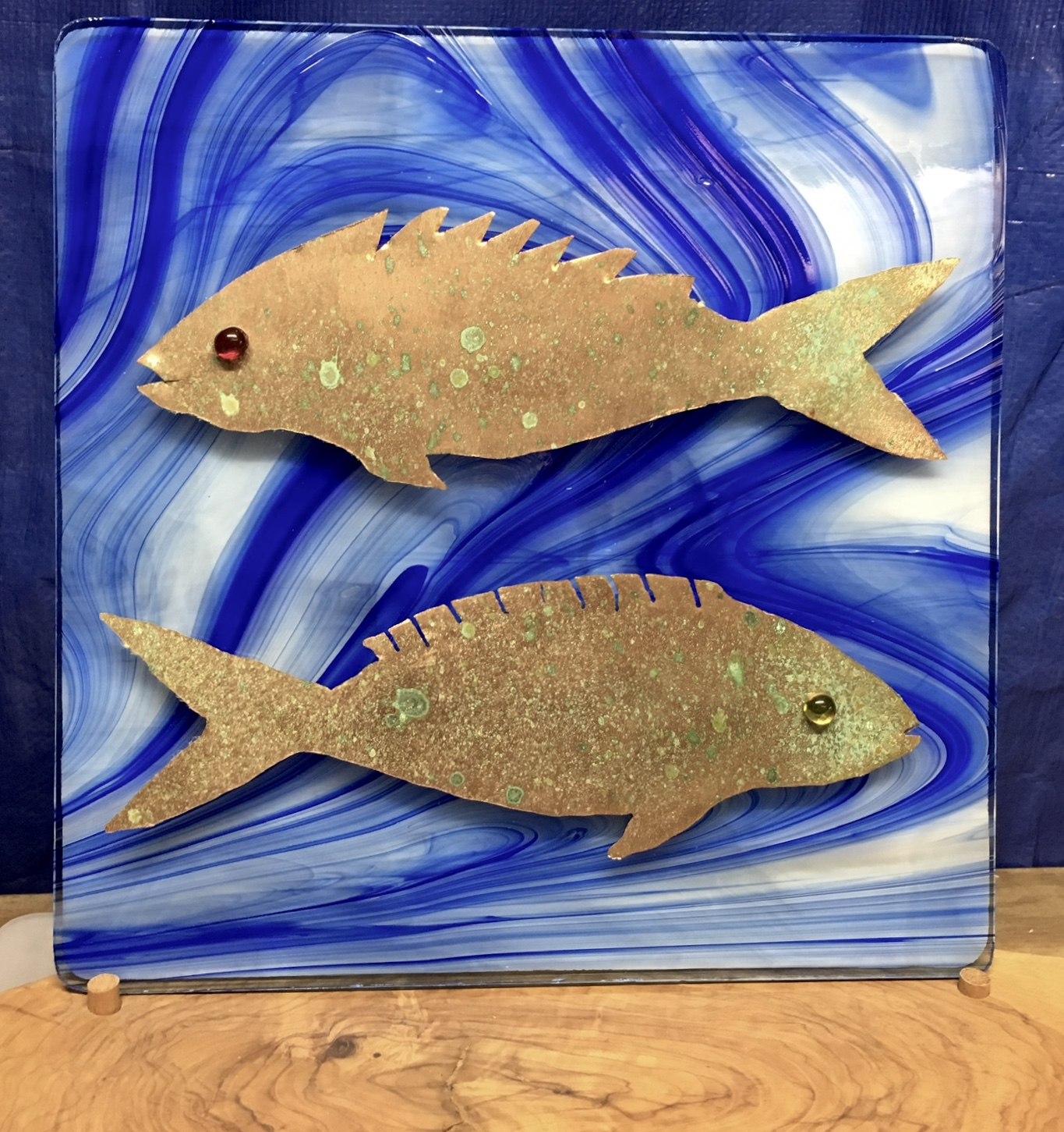 Copper fish on stained glass