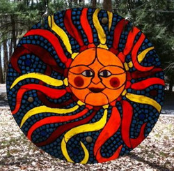 Mosaic sun in stained glass