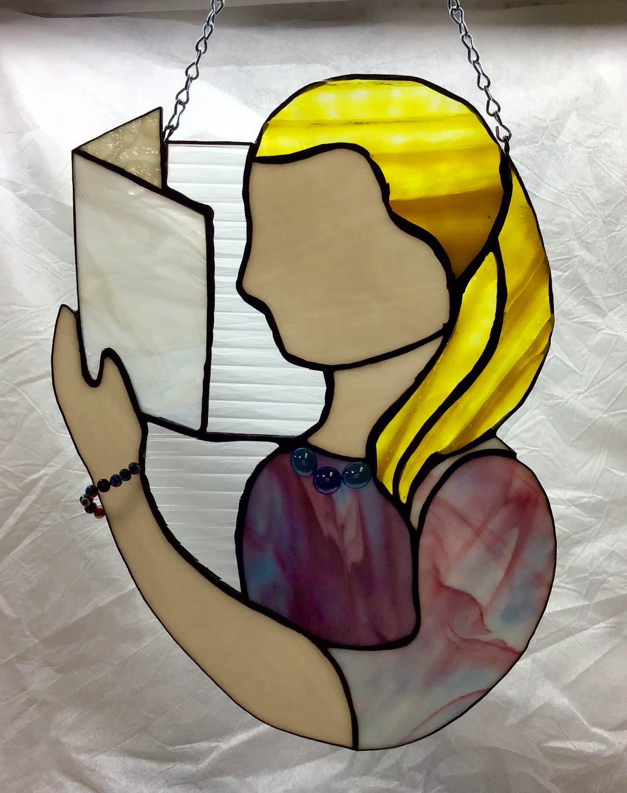 Stained glass book reader