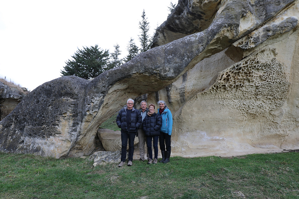 Four Trustees in front of limestone arch