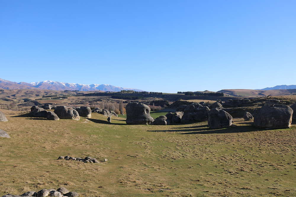 Limestone Outcrops on farmland in New Zealand near Duntroon, blue sky, clear winters day
