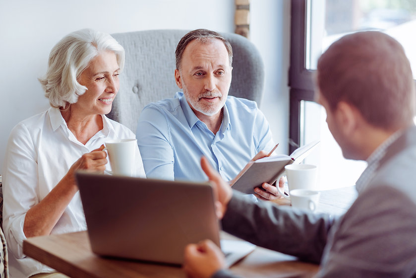 Positive aged couple consulting with ins
