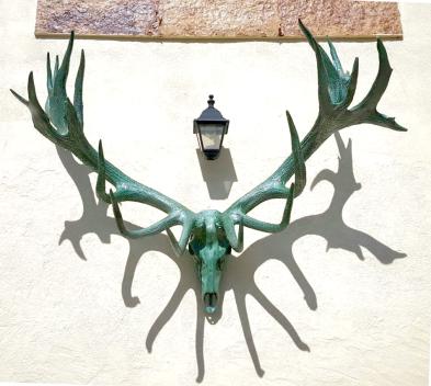 ciervo bronce