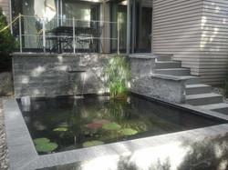 Wasser im Steingarten - Gärten & Pools Sven Studer AG