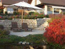 Steinmauer im Garten - Gärten & Pools Sven Studer AG