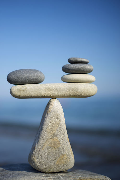 Balance of stones on a blue sky background with a copy space.jpg To weight pros and cons.jpg