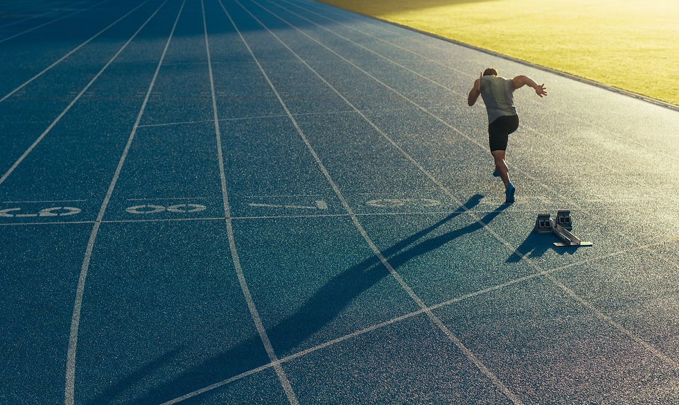 Athlete running on an all-weather runnin