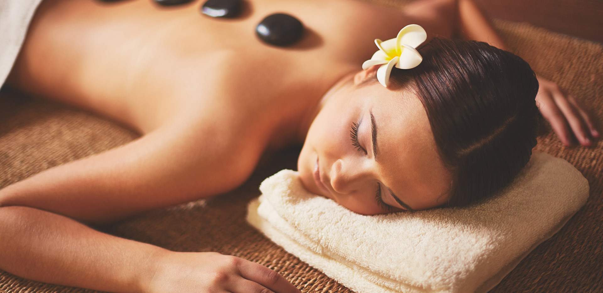 Woman-enjoying-stone-massage.jpg