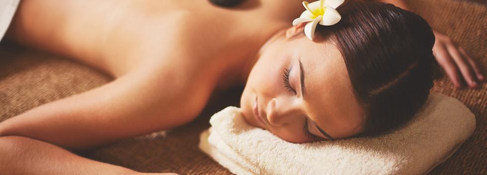Woman-enjoying-stone-massage.jpg