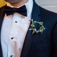 Let's not forget those men! We made eucalyptus wreaths for the groomsmen and the classic ranunculus for the groom boutonniere.jpg