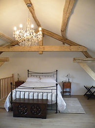 Oak Beamed Roof with candelier in your bedroom