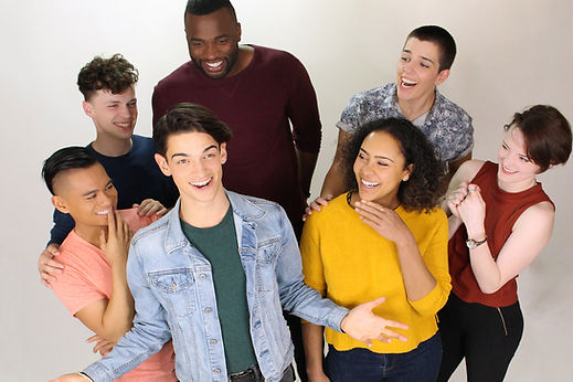 From the webseries Queen's English: a diverse group of actors, including Cha, stand against a white background, smiling and laughing together
