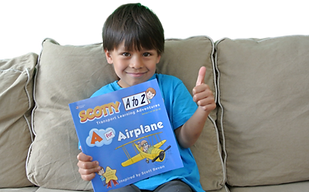 Kid Reading A Story Book on Airplanes