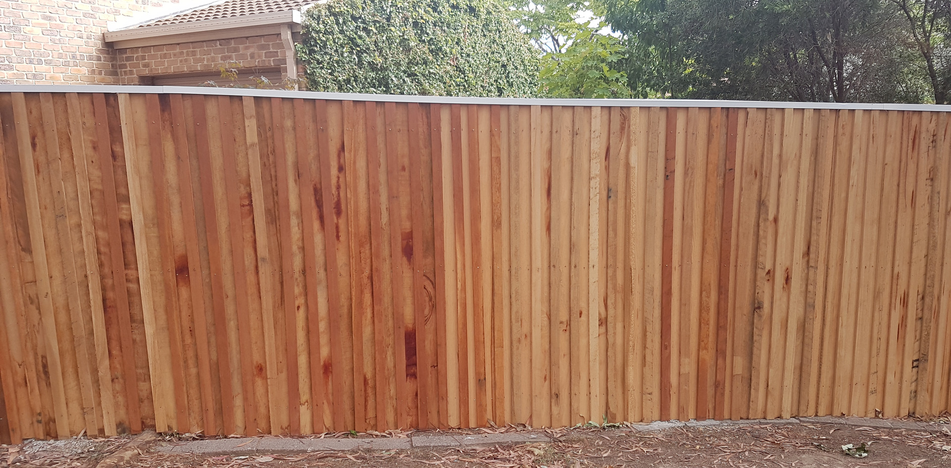 Lapped and capped timber fence.jpg