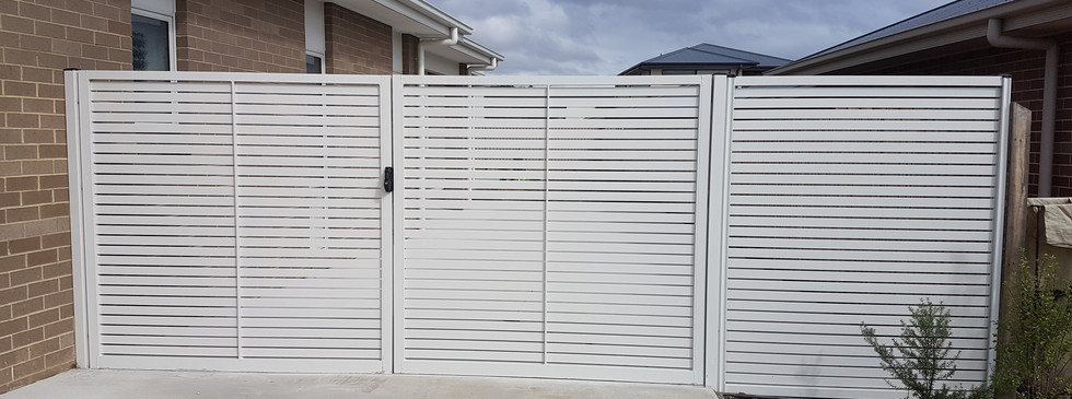 double gates and panel of metal slats.jp