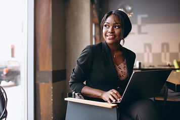 african-american-business-woman-working-computer-bar.jpg
