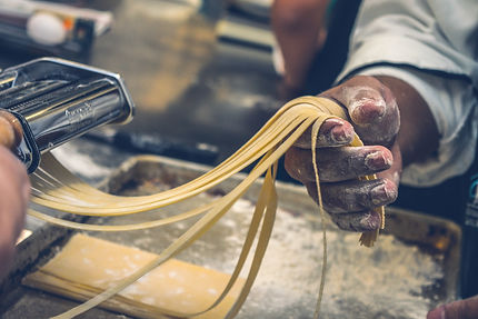 Canva - Person Making Pasta Tagliatelle