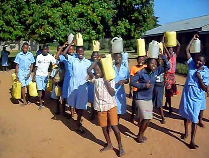 Water collectors at Namwaya Primary School in Namwaya Sub-County, Tororo. Credit: Photo/Ondege John.