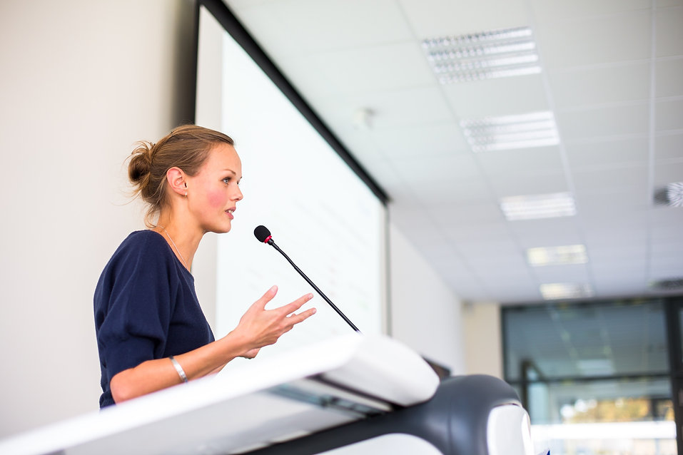 Female Researcher talking on a conference
