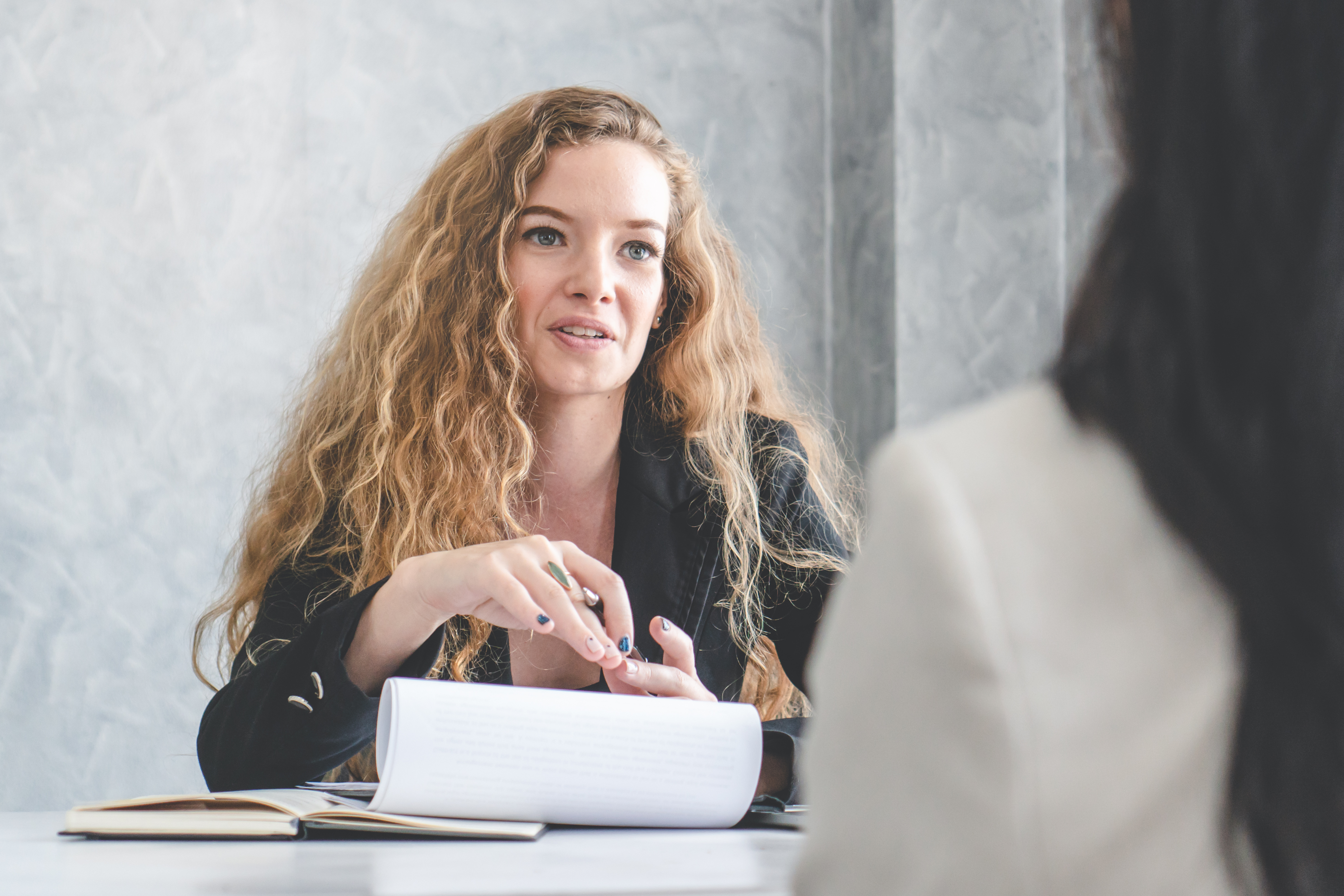 Friendly business woman interviewing new