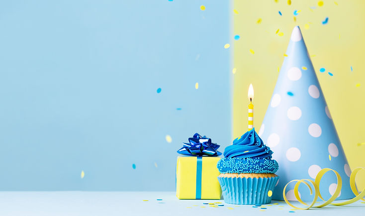 Birthday cupcake background with birthday gift, birthday party hat and falling confetti.jp