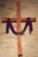 Rugged cross draped with purple cloth for Good Friday service