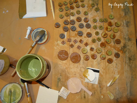 Colourful earthenware buttons by angry pixie.