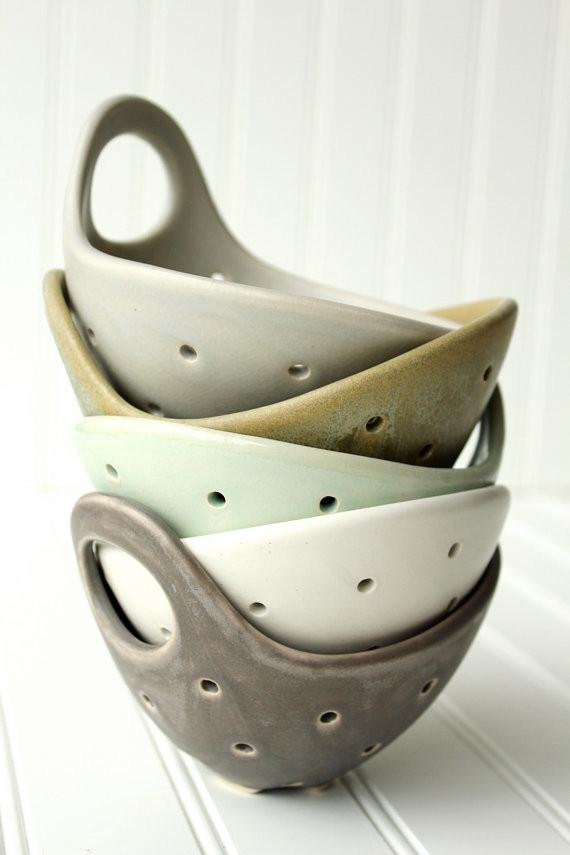 Ceramic colanders.
