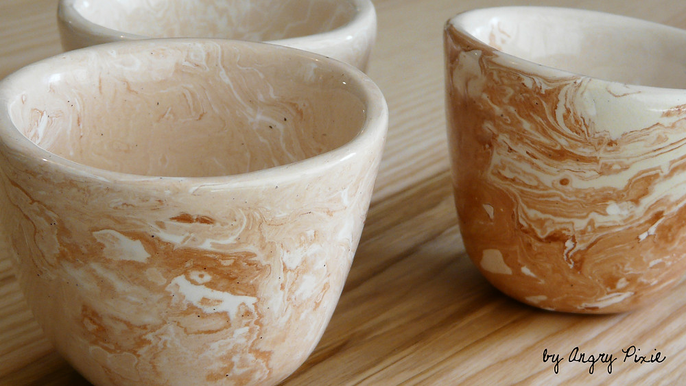 coffee cups by Angry Pixie