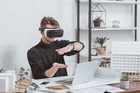 architect-in-vr-headset-at-workplace-with-laptop-s-AJDAR77.jpg