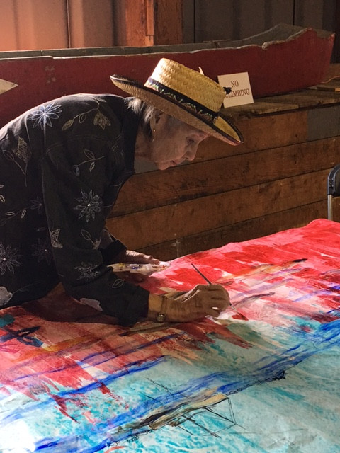 Contemplating the symbolism of place, painting the Heritage Scroll. Photo by Lori Sherritt-Fleming.