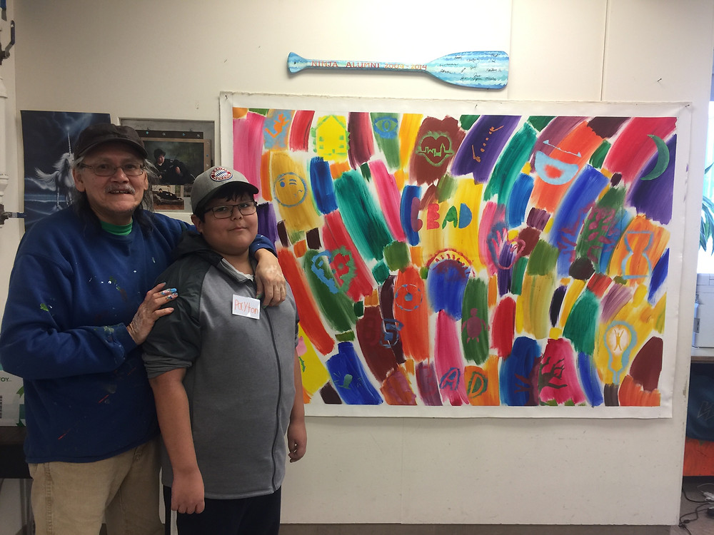 Jerry and his grandson, the finished mural. Photo by Lori Sherritt-Fleming