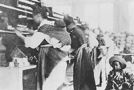 Japanese women working at a cannery with babies on their backs. Courtesy of BC Archives