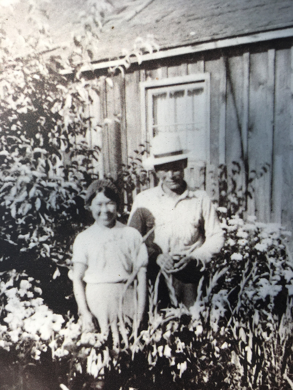 Asayo and Otokichi Murakami in their garden circa 1930's. Photo courtesy of BHS Society Photo Collection