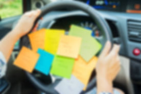 To do list in a car on driving wheel - b