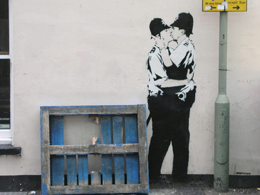Kissing Coppers, by Banksy, Brighton, UK
