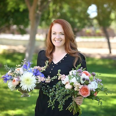 Michelle holding white, blue, and peach wedding flowers in Gilbert