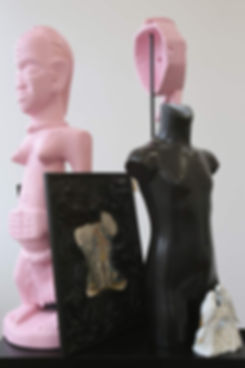 Sculptural work by Michael Forbes, including African masks, paintings, figurines, computer parts