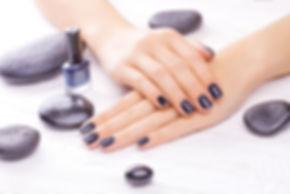 Black nail polish on manicured hands manicure with gel polish