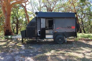 xh13-hybrid-caravan-side-view-door-open-