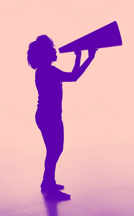 Silhouette%20of%20a%20female%20holding%20a%20analog%20megaphone._edited.jpg